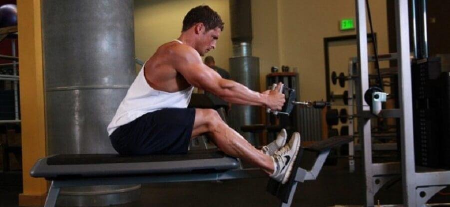 Тяга блока к поясу сидя: варианты и порядок выполнения упражнения